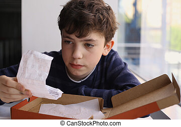 teenager boy check bill after dinner in pizzeria