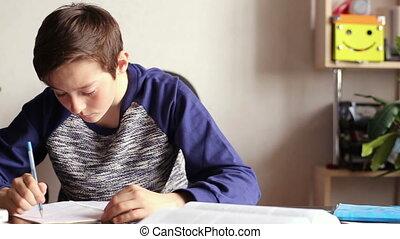 Teenager boy doing homework
