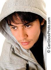 Handsome teenager boy, casual dressed, hip hop culture. Studio shot, white background