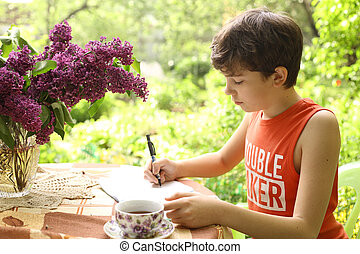 teenager boy make homework school on summer holiday