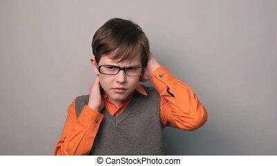 teenager boy migraine headache holding his head ten years in...