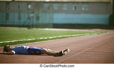 teenager boy playing sports stadium gymnastics warm-up...