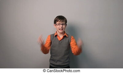 teenager boy succeeded joy waves his hands for ten years in...
