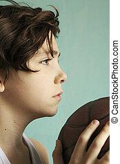 teenager boy with basketball ball half face