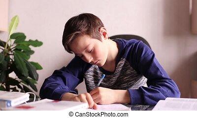 Teenager Boy Writing Someting