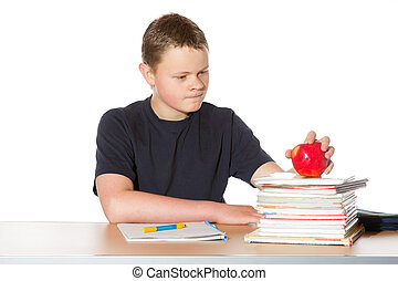 Teenager contemplating a ripe red apple