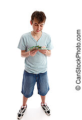 Teenager counting his money - A boy counting or sorting his ...