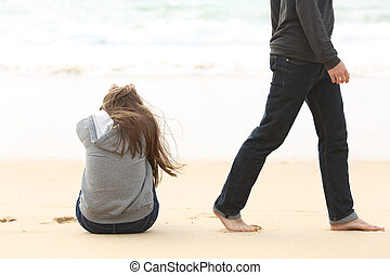 Teenager couple breaking up and ending relation after argument. Boyfriend legs leaves his sad girlfriend and go away