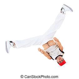Teenager dancing breakdance ain action
