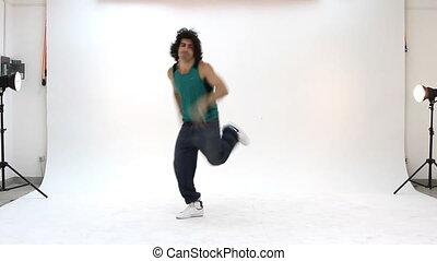 Teenager dancing breakdance in acti