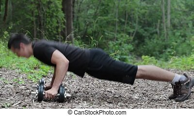 Teenager do push ups at outdoor in the park