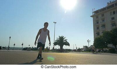 Teenager doing acrobatics on city square - Slow motion...