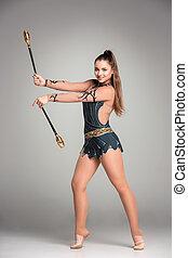teenager doing gymnastics exercises with gymnastic clubs on ...