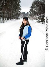 Teenager girl full-length portrait on the street at winter.