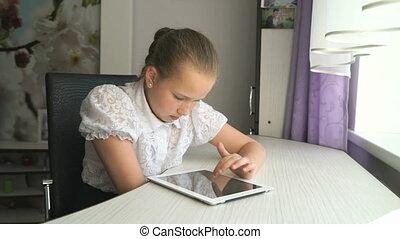 Teenager girl holding a digital tablet computer