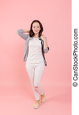 girl in white on a pink background