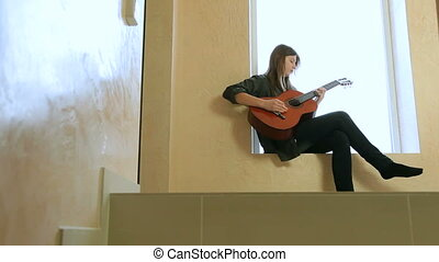 Teenager Girl Playing Guitar - Teen girl learning to play...