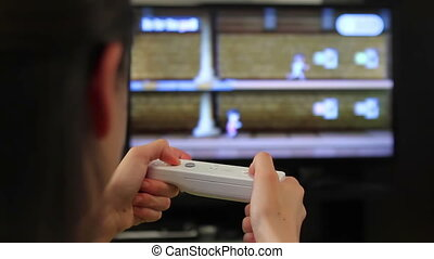 Teenager girl playing video games