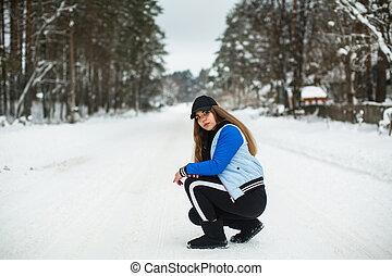 Teenager girl portrait outdoors in winter.