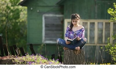 Teenager girl reading a book