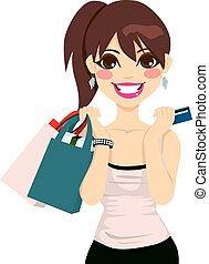 Beautiful teenager girl holding shopping bags and credit card