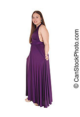 Teenager girl standing in her prom dress