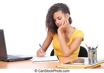Teenager girl studying on a desk