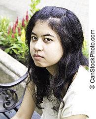 teenager girl sulks