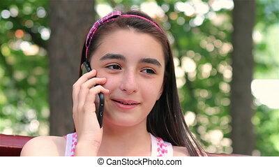 Teenager girl talking on smartphone