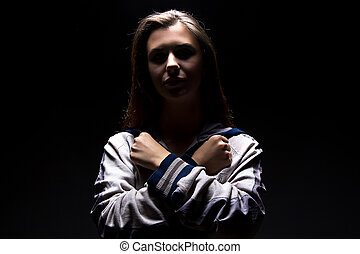 Teenager girl with arms crossed on her chest