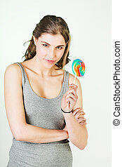 Teenager girl with lollipop
