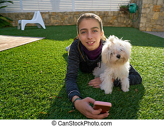 Teenager girl with mobile phone and doggy
