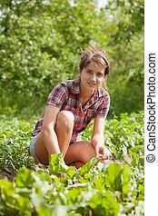 Teenager girl working in  field