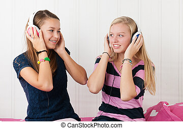 Teenager girls with headphones - Two teenager girls...