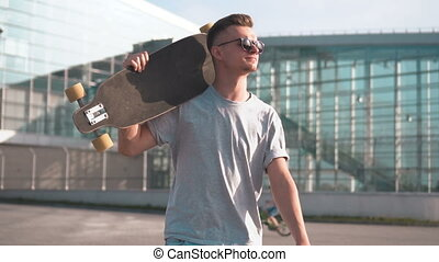 Teenager Going to Ride Skateboard