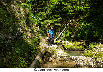 Teenager hiker in a canyon