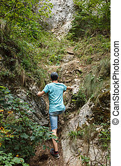 Teenager hiking on the steep trail