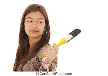 Teenager holding a brush