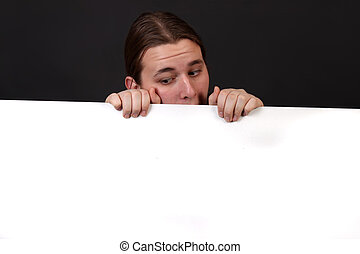Teenager holding blank sign