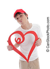 Teenager holding red love heart kiss - A teenage boy holding...