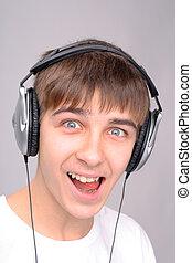 teenager in headphones - amazed teenager in the headphones ...