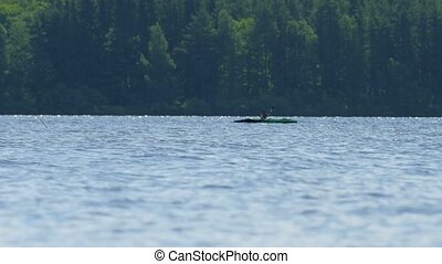 Teenager in lifejacket in kayak. Sunny day on wonderful...