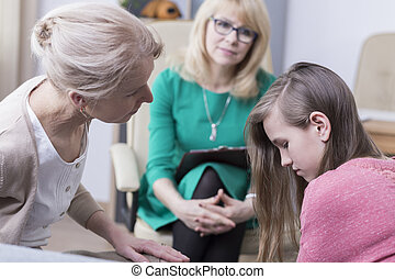 Teenager in mental health clinic - Teenage girl with mother...