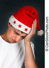 Teenager in Santa Hat feels Headache
