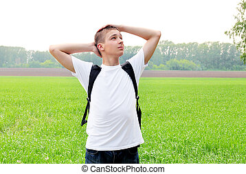 teenager in the field - happy teenager in the summer field