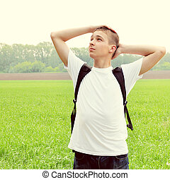 Teenager in the Field - Toned photo of Teenager at the...