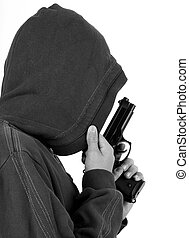 Teenager in the hood with gun, black and white tone.
