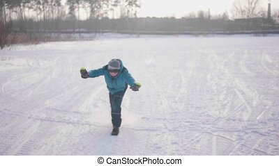 Teenager in the winter Park doing sports. Run in the winter outdoors. Healthy lifestyle