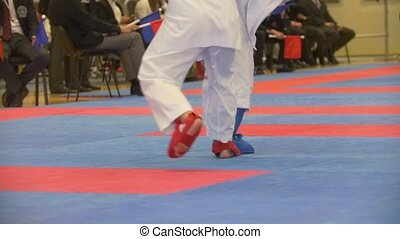 Teenager karate fighters at the karate championship, slow...