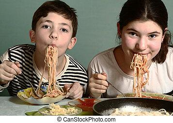 teenager kids boy and girl with spaghetti